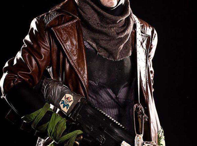 Trenchcoat batma holding gun